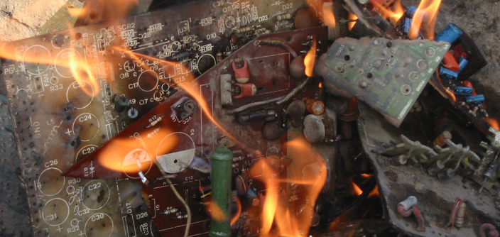 A photograph of e-waste being chemically treated