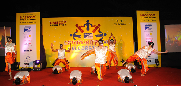 A photograph of a performance by corporate volunteers at the Pune CSR Forum conducted by NASSCOM Foundation