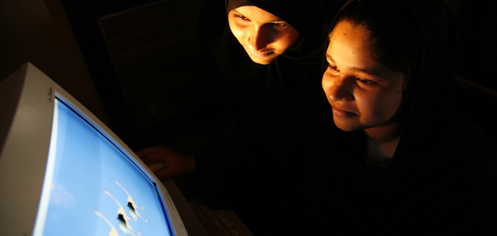 A photograph of two girls learning animation on a computer